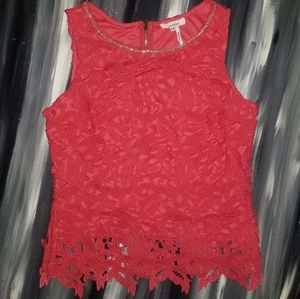 Lace cutout sleeveless top with rhinestone accents
